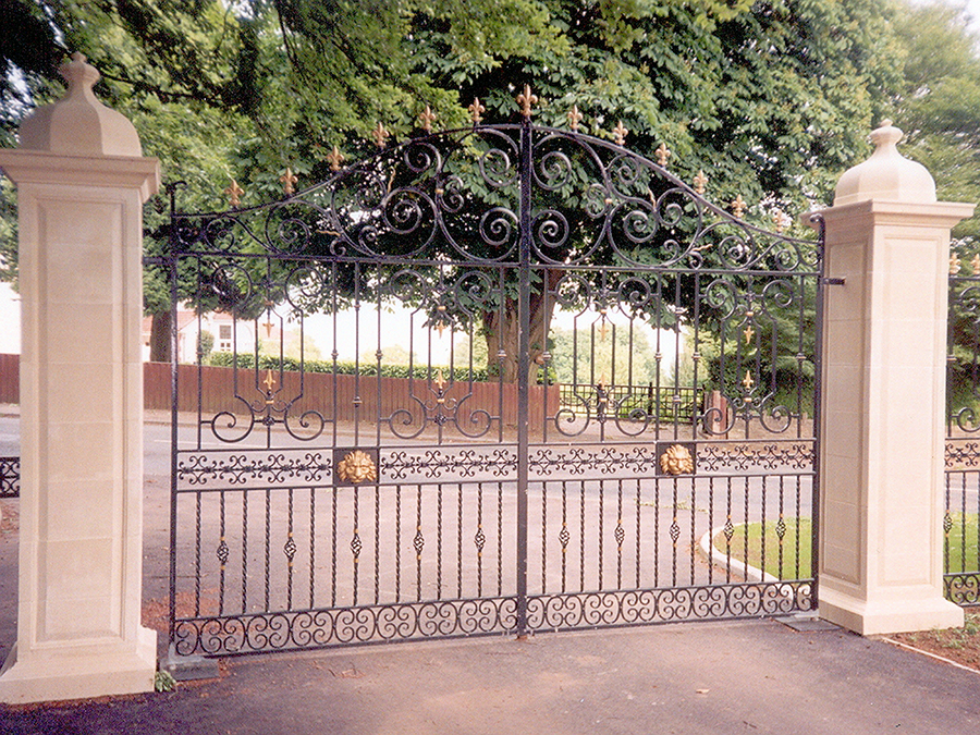 Chepstow Entrance Gates. Designed with decorative wrought iron panels to the gates and twisted bars with basket inserts.