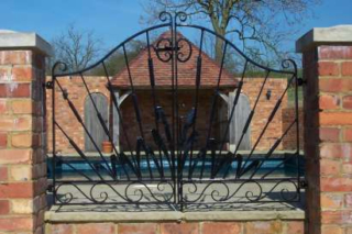 Bullrush Gates. Decorative bulrush design. Used here on entrance to swimming pool area.