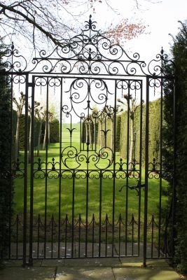 Cheltenham Gate . Single decorative garden gate with two side pieces and ornate overthrow. Hand crafted scroll work incorporated into these wrought iron gates.