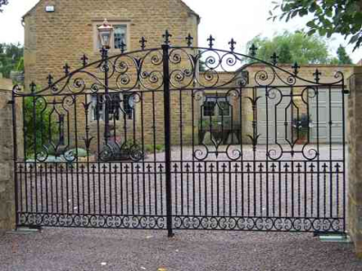 Compton Entrance Gates. Hand forged wrought iron gates with decorative panels.