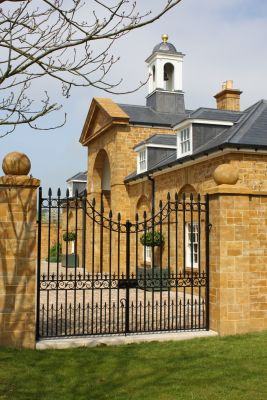 Courtyard Gate . Classical style Georgian based gate design with hand forged iron scrolls and spear rail heads.