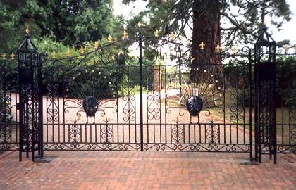 Peacock Entrance Gates. Decorative wrought iron gates incorporating sculptured peacocks.