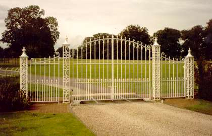 Shrewley Driveway Gates. Elegantly simple wrought iron gates with matching piers & side gates.     